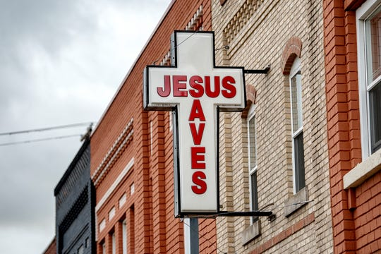 "A ""Jesus Saves"" sign sits above the City Rescue Mission of Lansing building on the 600 block of East Michigan Avenue. The mission has had a presence along the corridor for over 100 years."