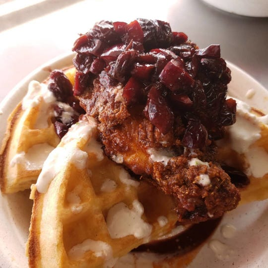 Nashville hot chicken and sourdough waffle with drunk cherries and smoked blue cheese, served at one of Street Kitchen's pop-up brunches.