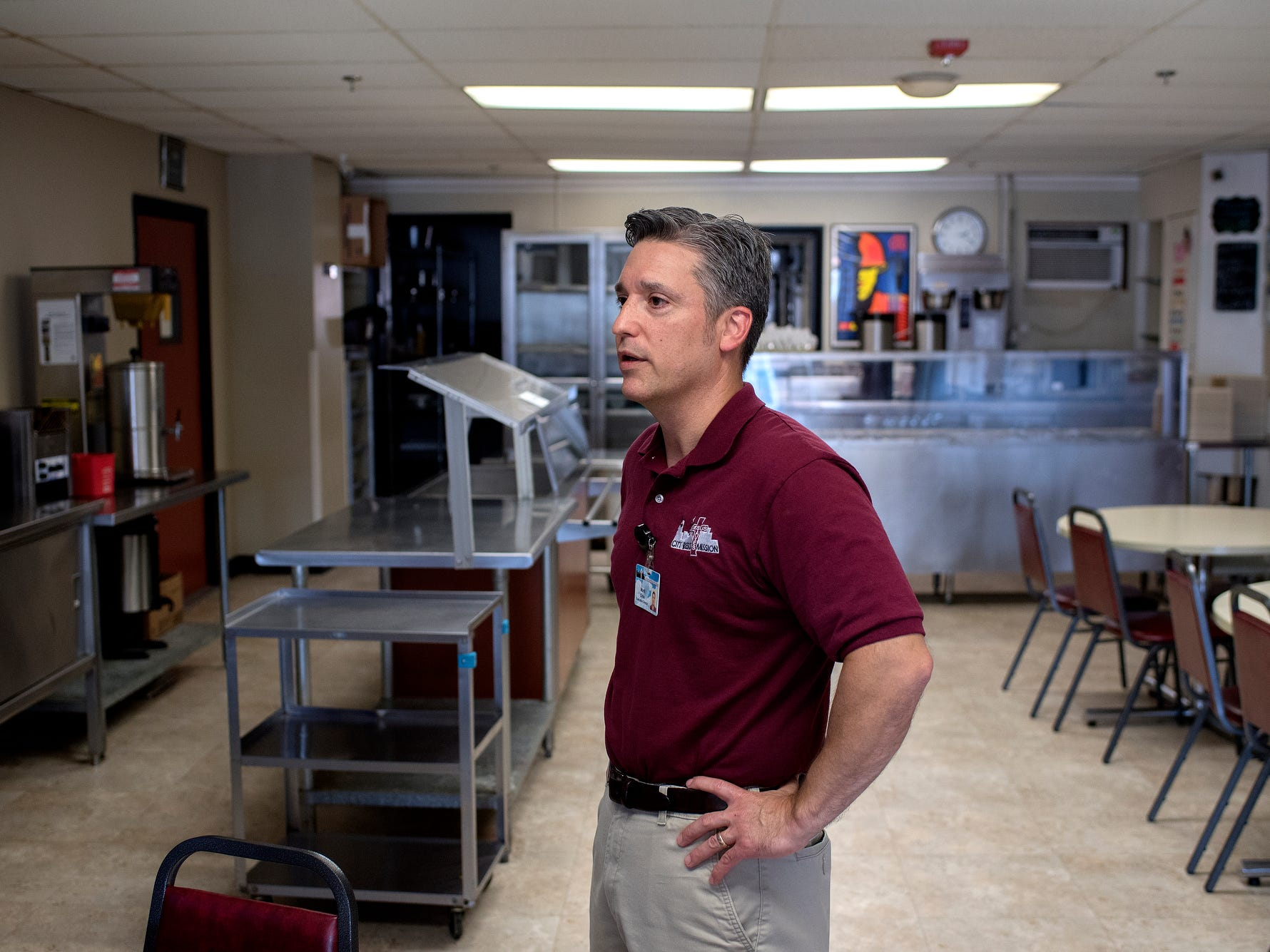 Executive director Mark Criss talks about the cafeteria during a tour of the City Rescue Mission on Tuesday, Sept. 4, 2018, in downtown Lansing.