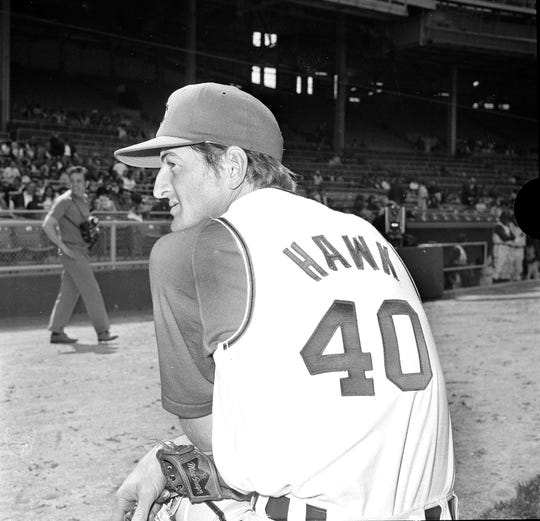 "Ken ""Hawk"" Harrelson sizes up the situation from the Cleveland Indians' dugout before the start of their game with the Washington Senators in Cleveland, April 26, 1969. The Hawk came to Cleveland from Boston in a six-player trade."