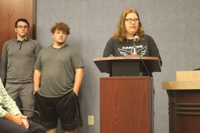 """Marion Harding Student Megan Large shares with county commissioners about food insecurity in the community during their meeting on Tuesday. They had signed a proclamation declaring September """"Hunger Action Month"""" in Marion County."""