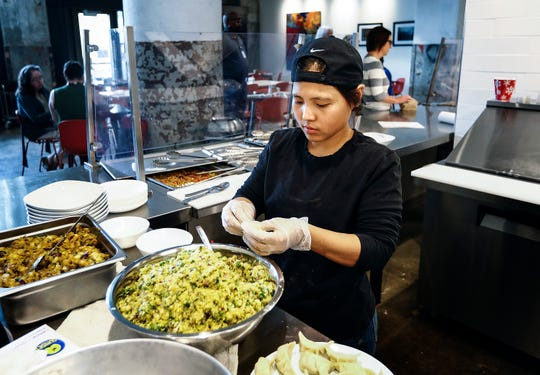 Global Cafe Nepalese chef Indra Sunuwar prepares momo vegetarian dumplings in the 2,500-square-foot restaurant inside Crosstown Concourse.  The cafe features dishes from Nepalese, Syrian and Sudanese immigrants or refugees.