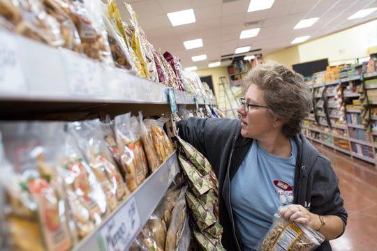 September 11 2018 - Trader Joe's crew member Jess Guthrie stocks the shelves inside of the new Trader Joe's grocery store in Germantown.
