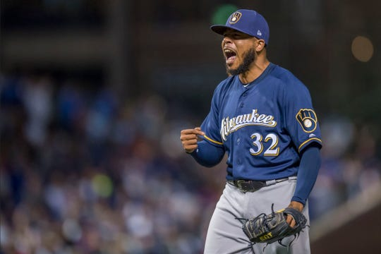 Jeremy Jeffress celebrates after getting the third out in the ninth inning on Monday night.