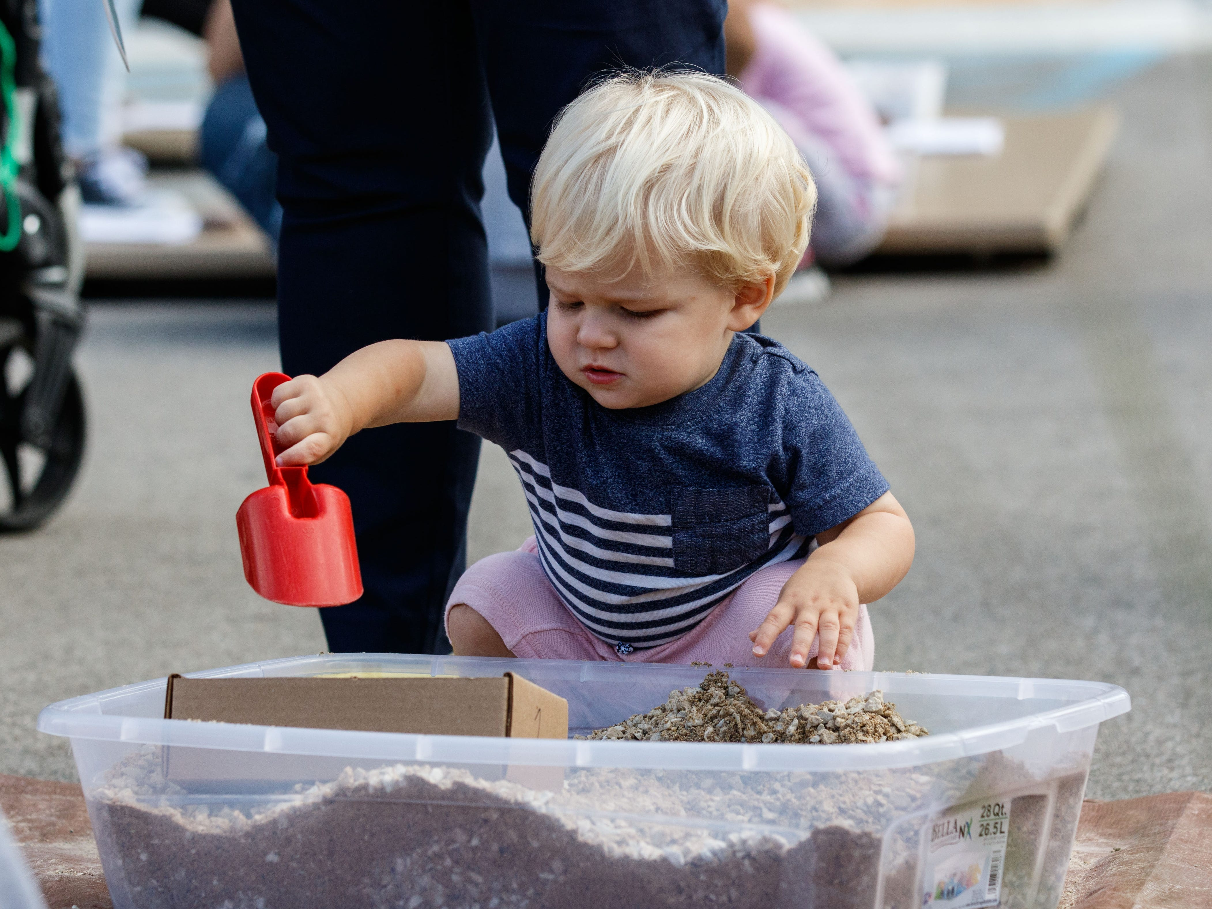Seventeen-month-old Elliott Gale of Sussex keeps busy in the children's play area during the Sussex Touch-a-Truck event at the Civic Center on Monday, Sept. 10, 2018.