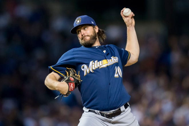 Brewers starting pitcher Wade Miley pitches during the second inning.