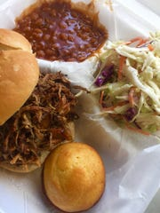 Smoked @ 225's pulled pork sandwich with sides of baked beans and coleslaw.