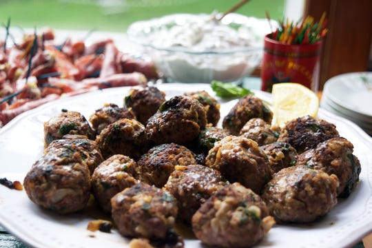 Moroccan Lamb Meatballs are served with a minty yogurt sauce.