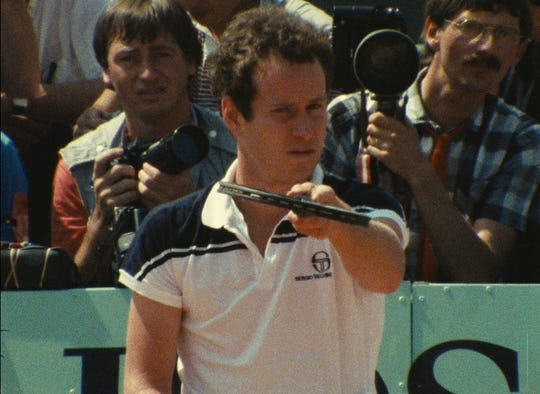 "John McEnroe stares down a camera in a scene from ""John McEnroe: In the Realm of Perfection."""