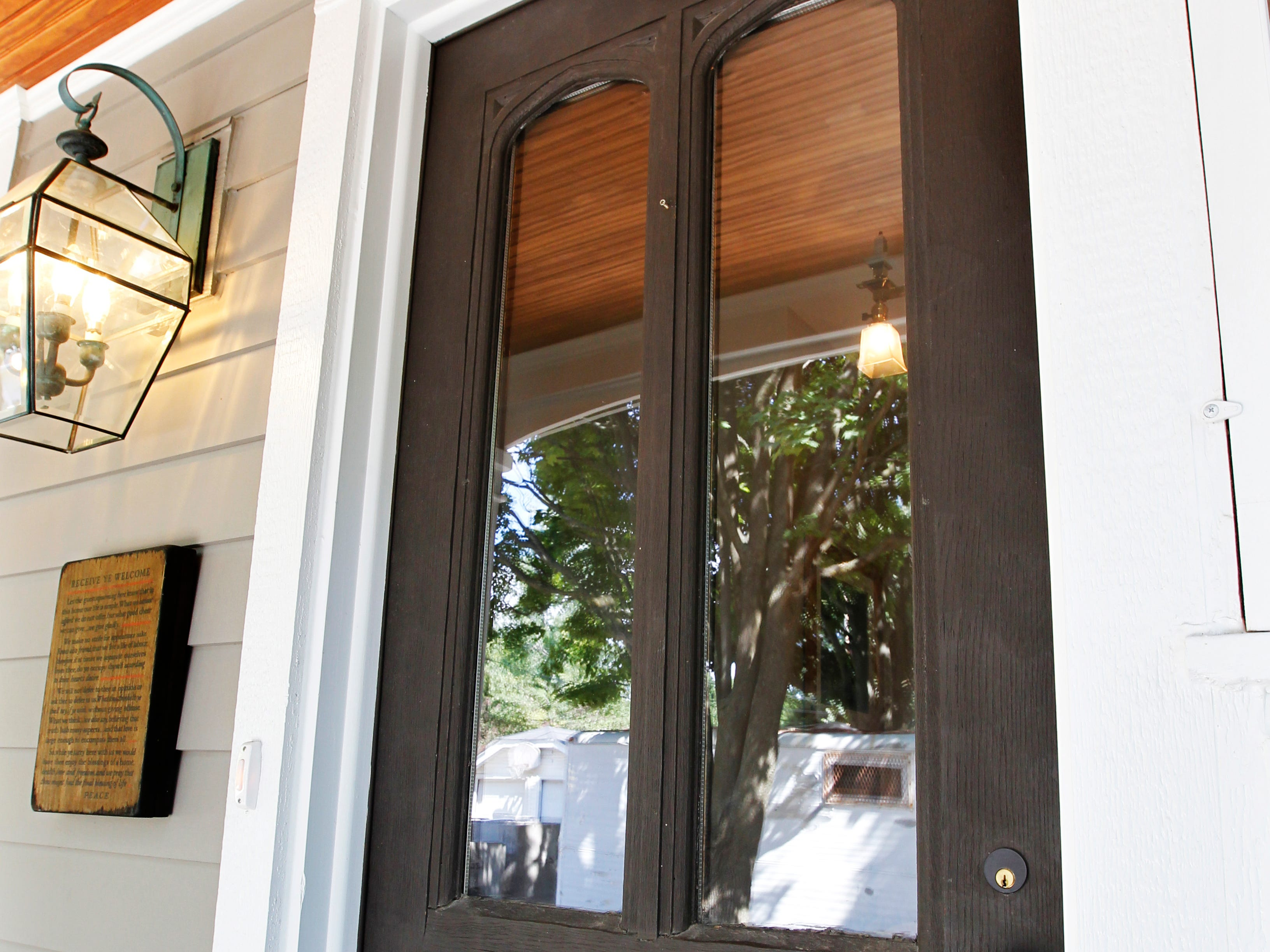 An antique wood door, salvaged from a home in Oshkosh, replaced the old front door of the house.