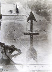 This is the first known photo of the Red Arrow insignia for the Wisconsin National Guard's 32nd Infantry Division from World War I. It was painted on the shrapnel-damaged front armor shield of an artillery piece that protected the soldiers who fired it.