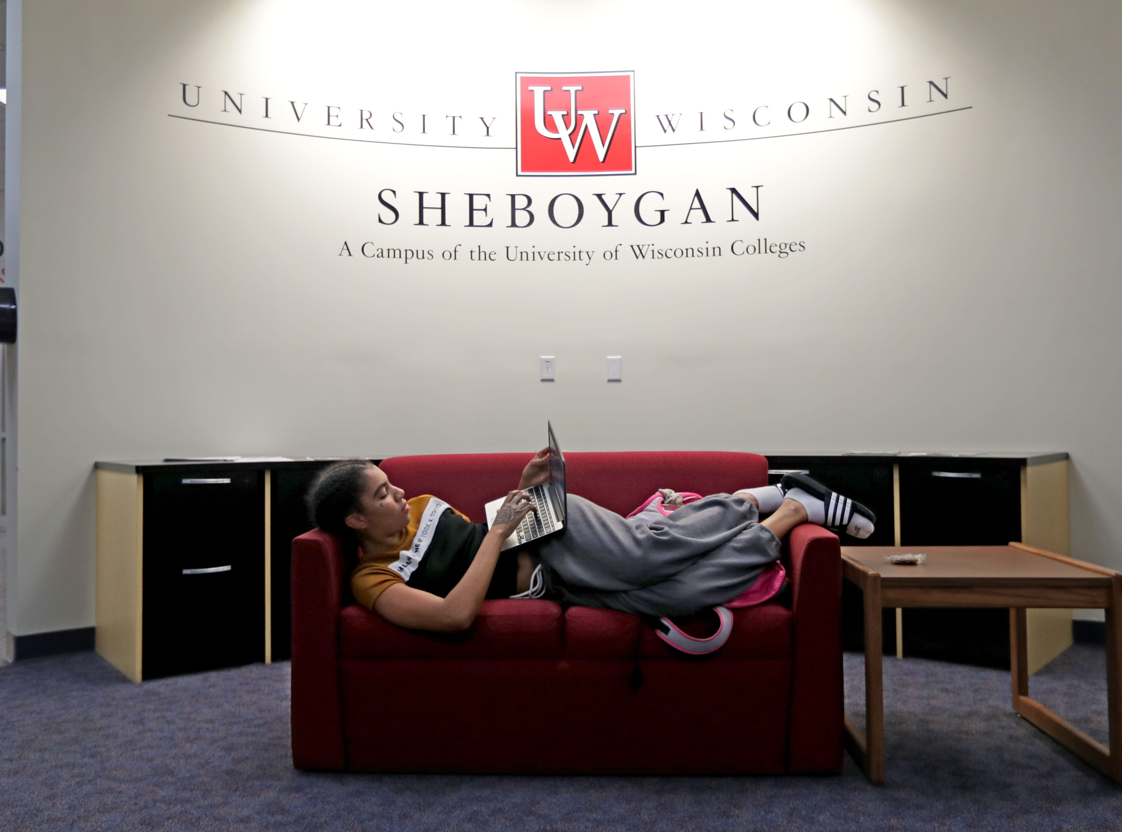 Taniza Tabbert, a University of Wisconsin-Green Bay, Sheboygan Campus sophomore from Fond du Lac, relaxes while working on her laptop before a class.