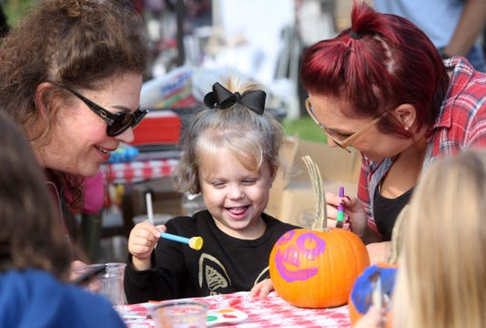 Scarlet Kleeba 3 Paints A Pumpkin Under The Watchful Eyes Of Her Grandmother Susan Grall Left And Her Mother Christa Kleeba They Attended The Cheery Cherry Fall Fair In Menomonee Falls On Sept 25