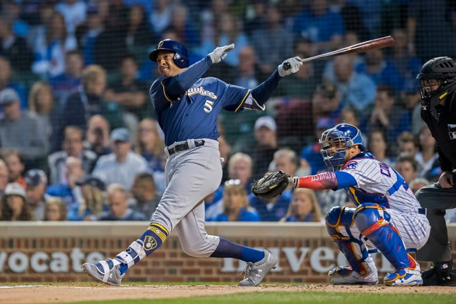 The Brewers' Jonathan Schoop drives in a run with a sacrifice fly during the first inning Monday night in Chicago.