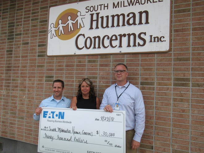 The South Milwaukee Human Concerns received a $30,000 donation from Eaton Corporation. At the check presentation on Aug. 29 were (from left) Eaton South Milwaukee Production Manager Art Davis, SMHC Director Deb DeBoerand Bruce Figi, Eaton South Milwaukee plant manager. The SMHC relies on donations to maintain programs like the food pantry.