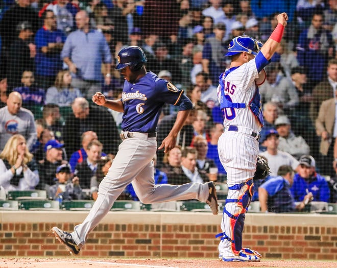 Lorenzo Cain scores the first rund of the game for the Brewers on a sacrifice fly by Jonathan Schoop in the first inning on Monday night.