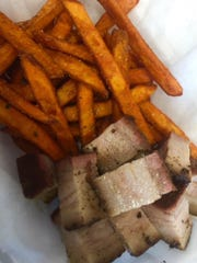 Smoked @ 225 offers both baskets and meals. Baskets, such as this one with pork belly, are served with either fries or sweet potato fries for $1 extra.