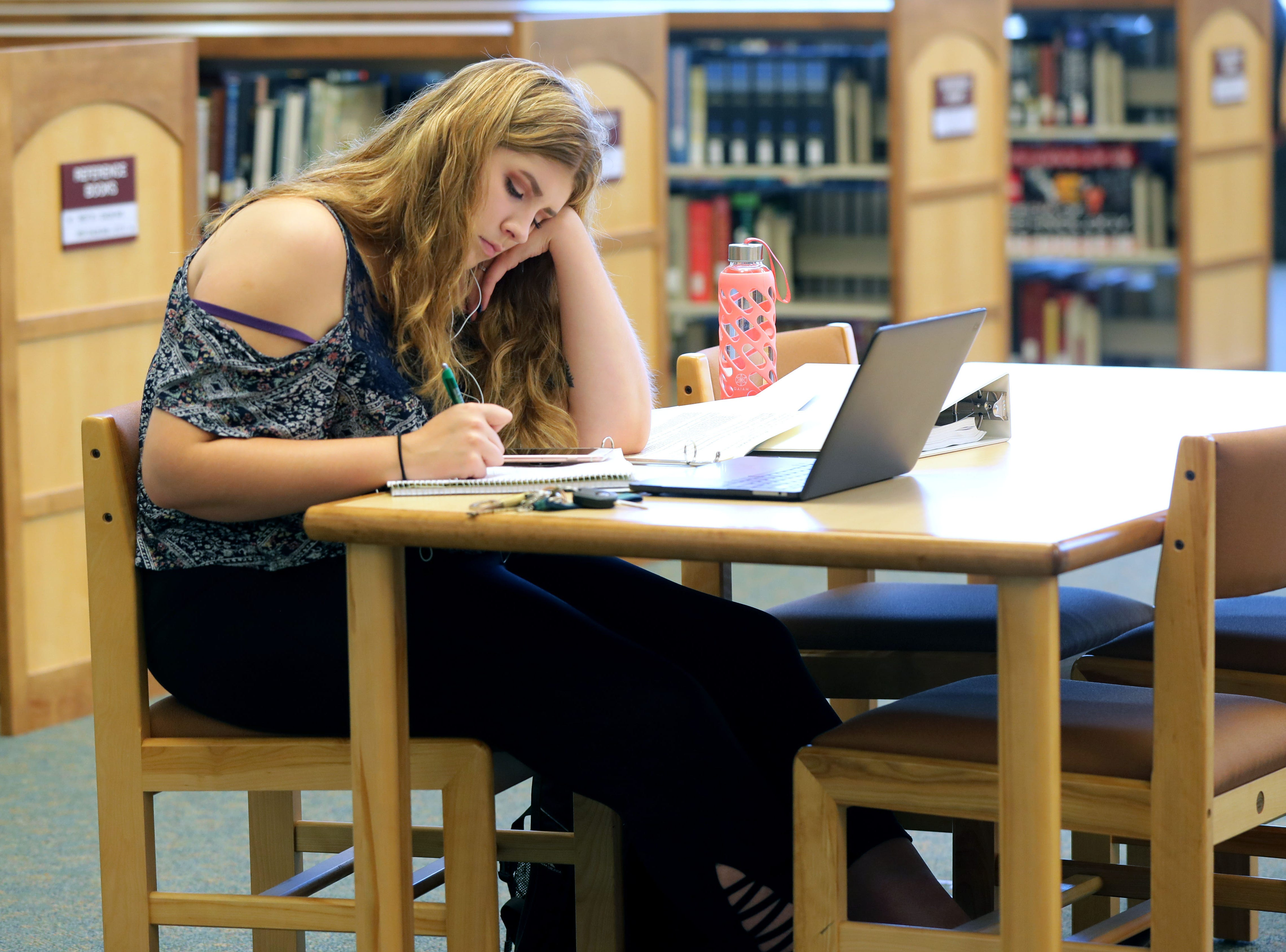 Anissa Levister, freshman majoring in substance abuse counseling from Plymouth, studies at the University of Wisconsin-Green Bay, Sheboygan Campus library.