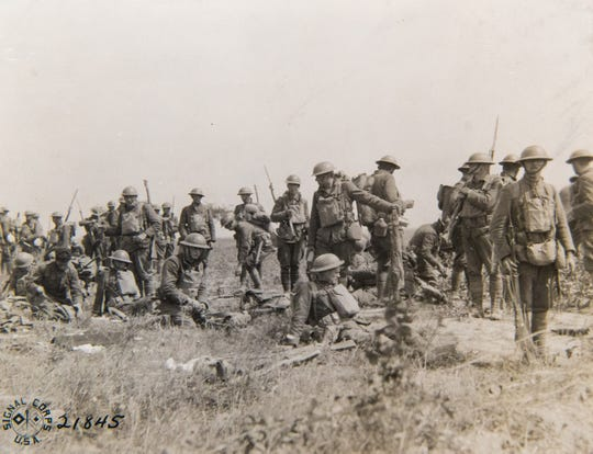 """32nd Division soldiers prepare for the Battle of Juvigny on Aug. 29, 1918. The division earned its nickname """"Red Arrow"""" for slicing through enemy lines in this battle and others during World War I."""
