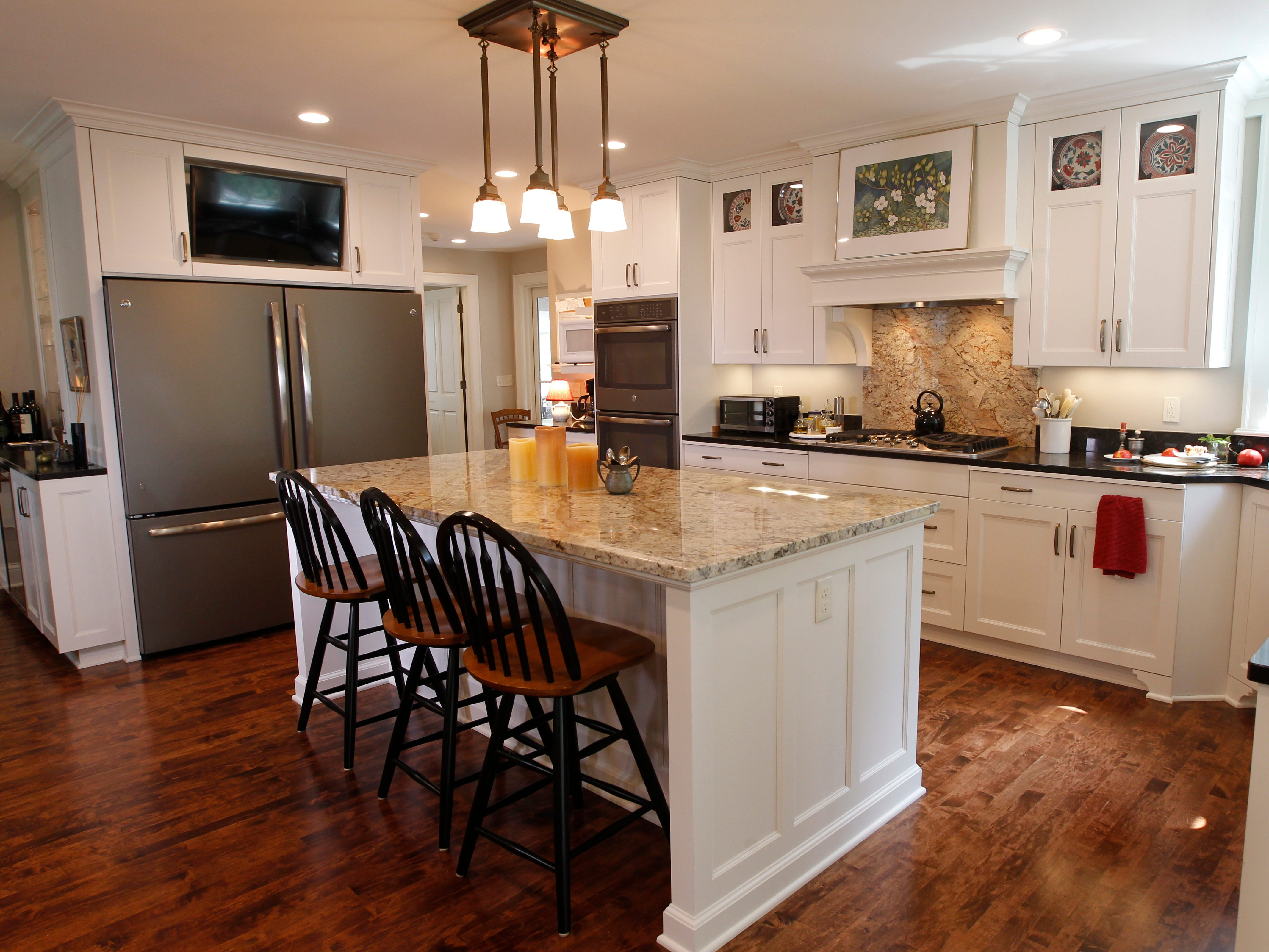 A large island was placed in the center of the kitchen with room enough for either a walker or wheelchair for better accessibility. It features separate storage areas for all three residents.