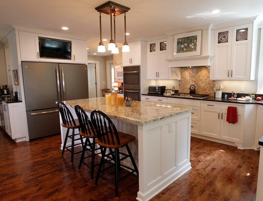 A large island was placed in the center of Susan Cerletty's kitchen with room enough for either a walker or wheelchair for better accessibility. It features separate storage areas for all three residents.