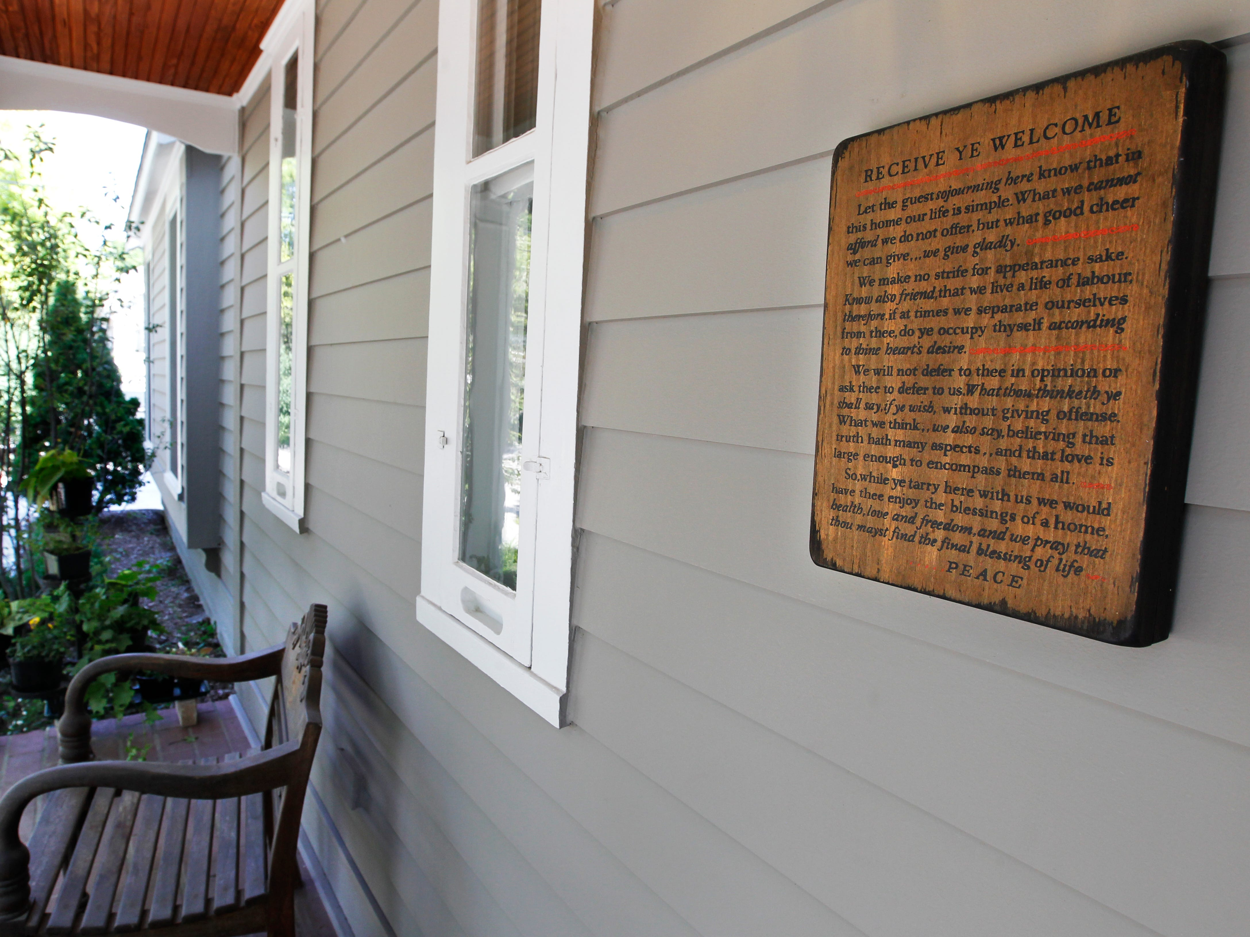 A sign on the front porch welcomes visitors.