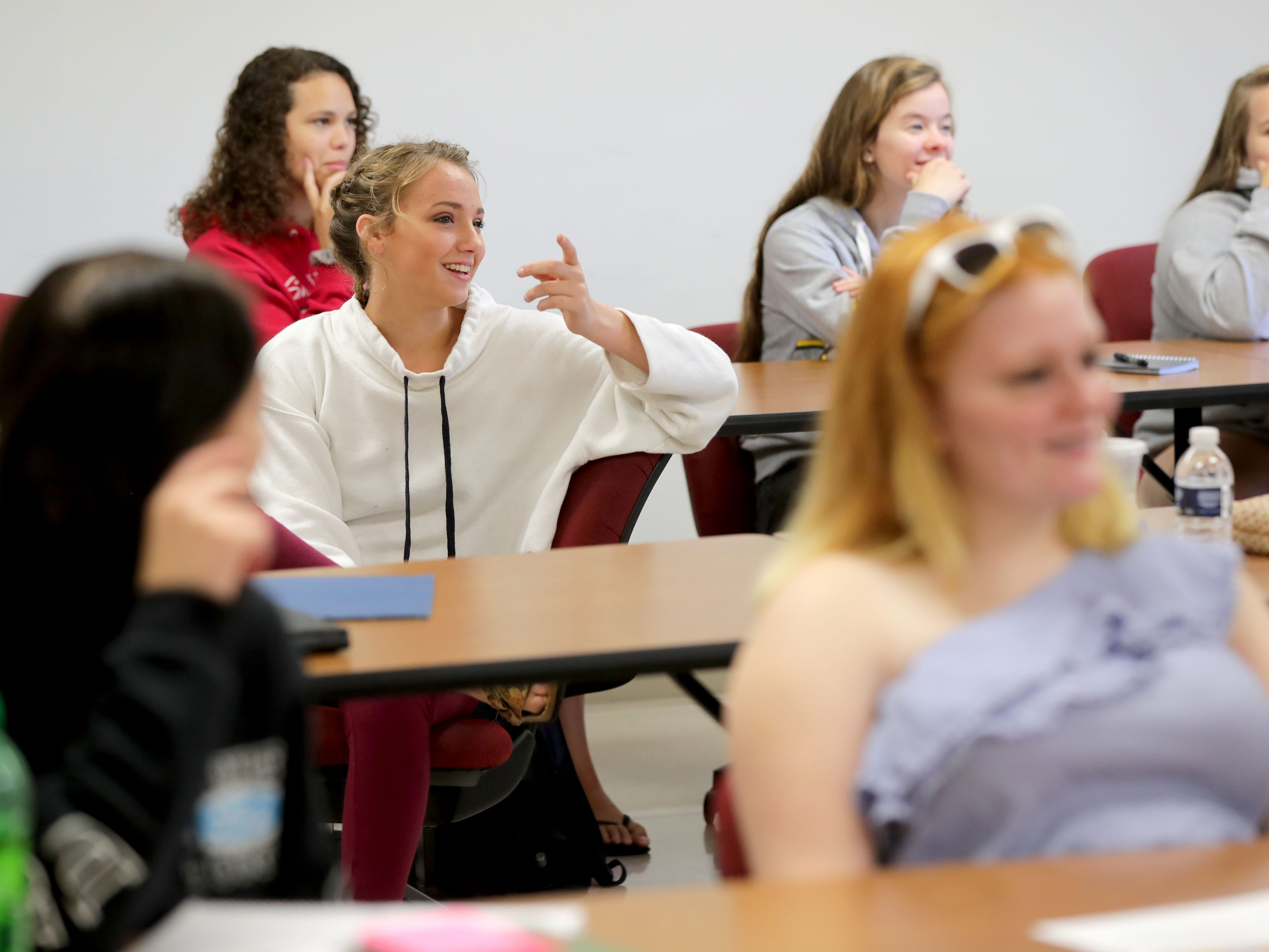 Emily Mihm (center), a University of Wisconsin-Green Bay, Sheboygan Campus freshman from Sheboygan,  answers a question in an academic reading class.