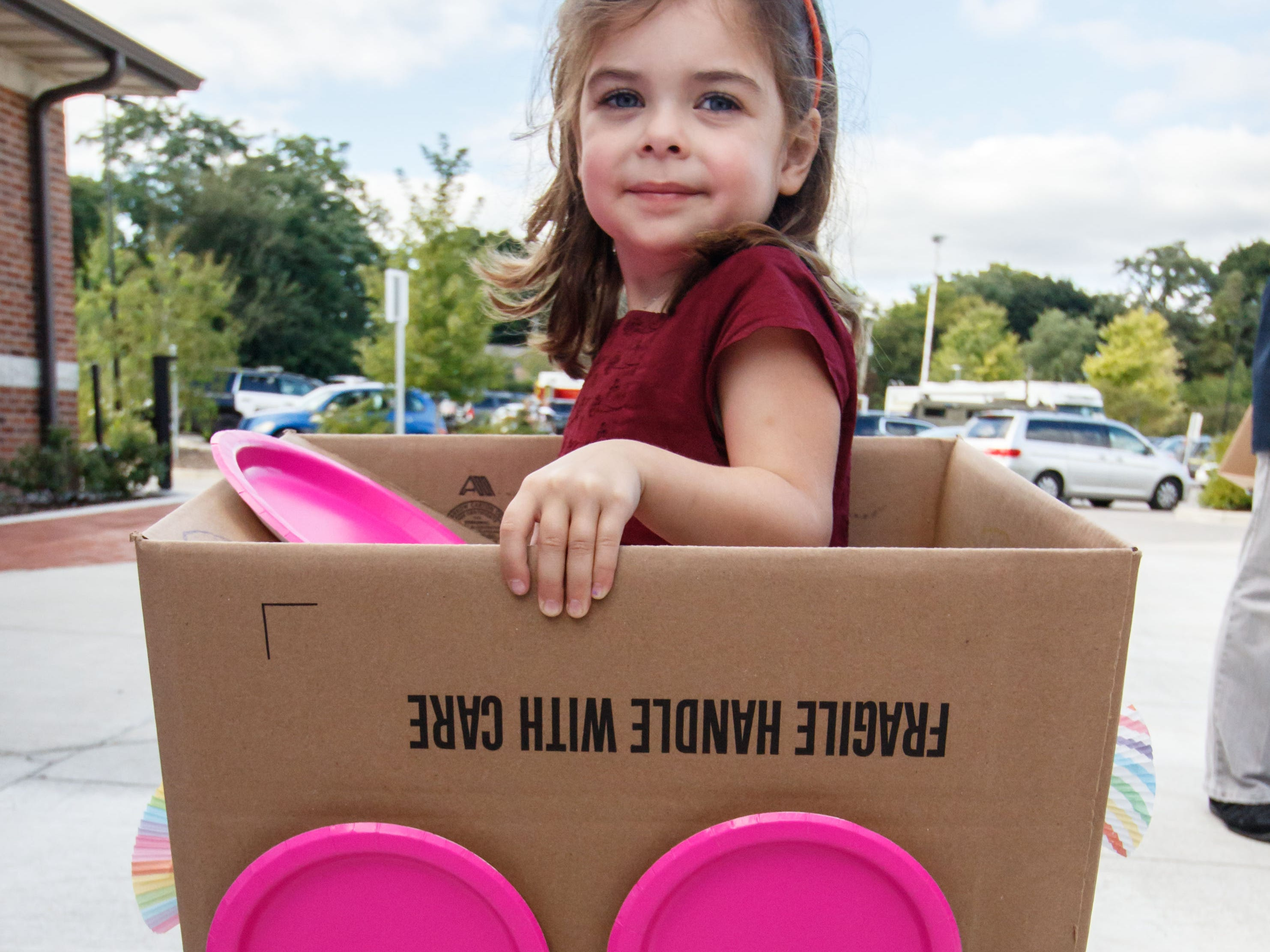 "Four-year-old Rhett Crook of Sussex created this color coordinated cardboard car at the Pauline Haass Public Library's ""build-a-car"" workshop during the Sussex Touch-a-Truck event on Monday, Sept. 10, 2018. The free event, located behind at the Civic Center, features emergency vehicles, fire trucks, police cars, construction vehicles and more."