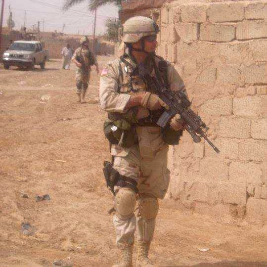Brian Faltinson (right) in Iraq while serving in the Wisconsin National Guard on a 2004-'05 deployment. Faltinson is now a major and Wisconsin Army National Guard historian.