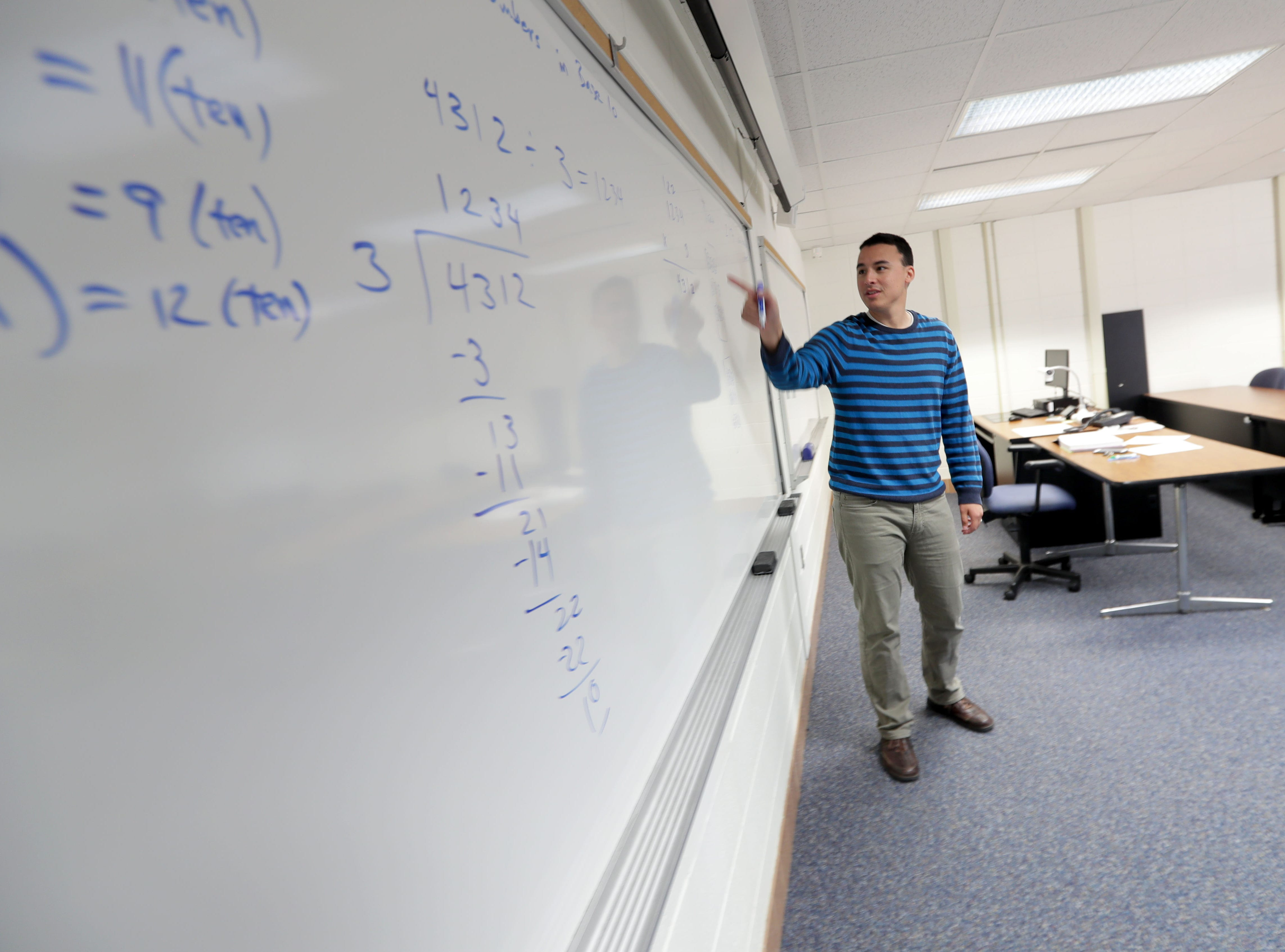 University of Wisconsin-Green Bay, Sheboygan Campus mathematics instructor Devin Bickner teaches his mathematics for elementary teachers class.