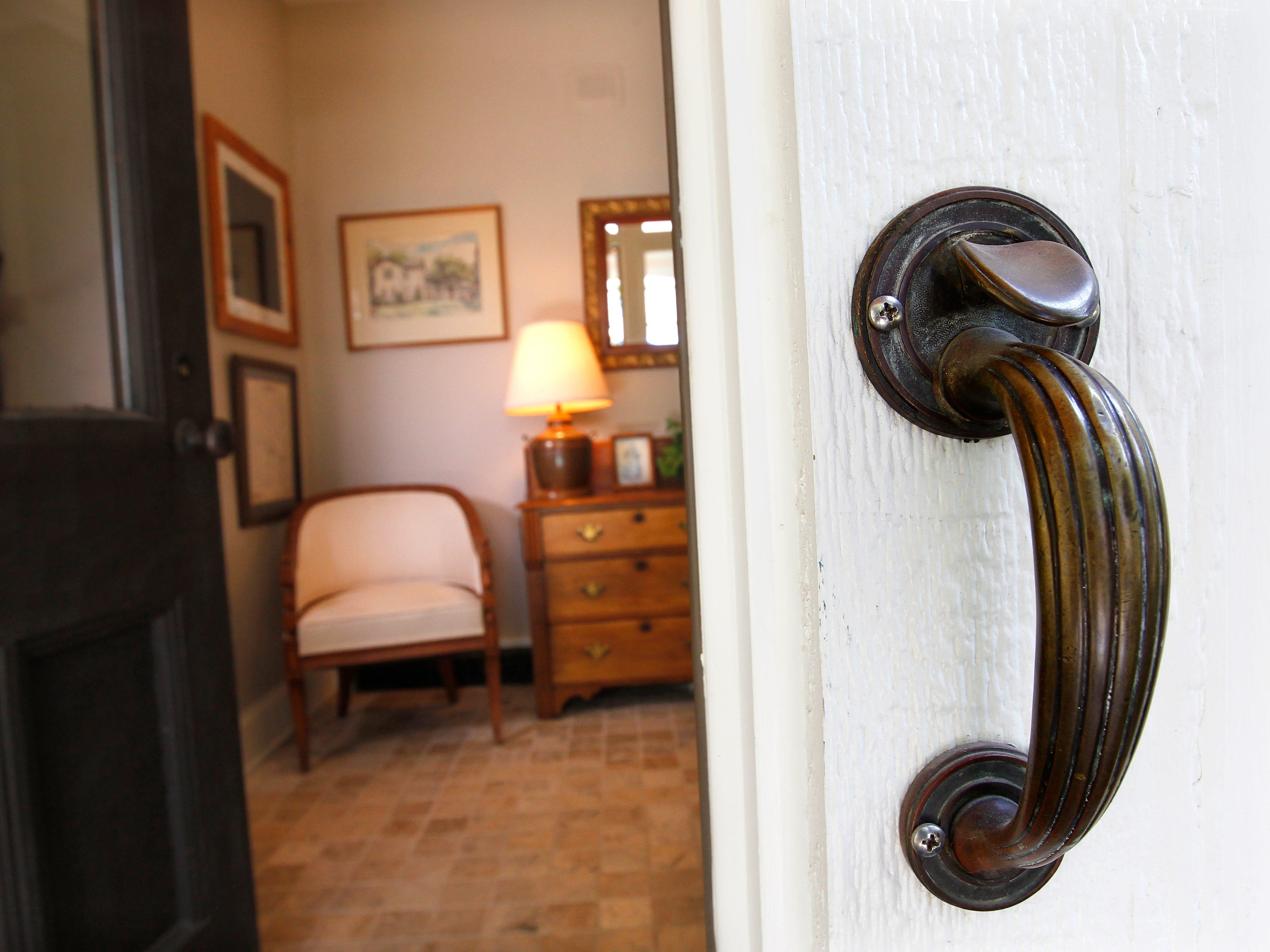 A door handle from the home's original front door was added as a grab bar for the new front door.