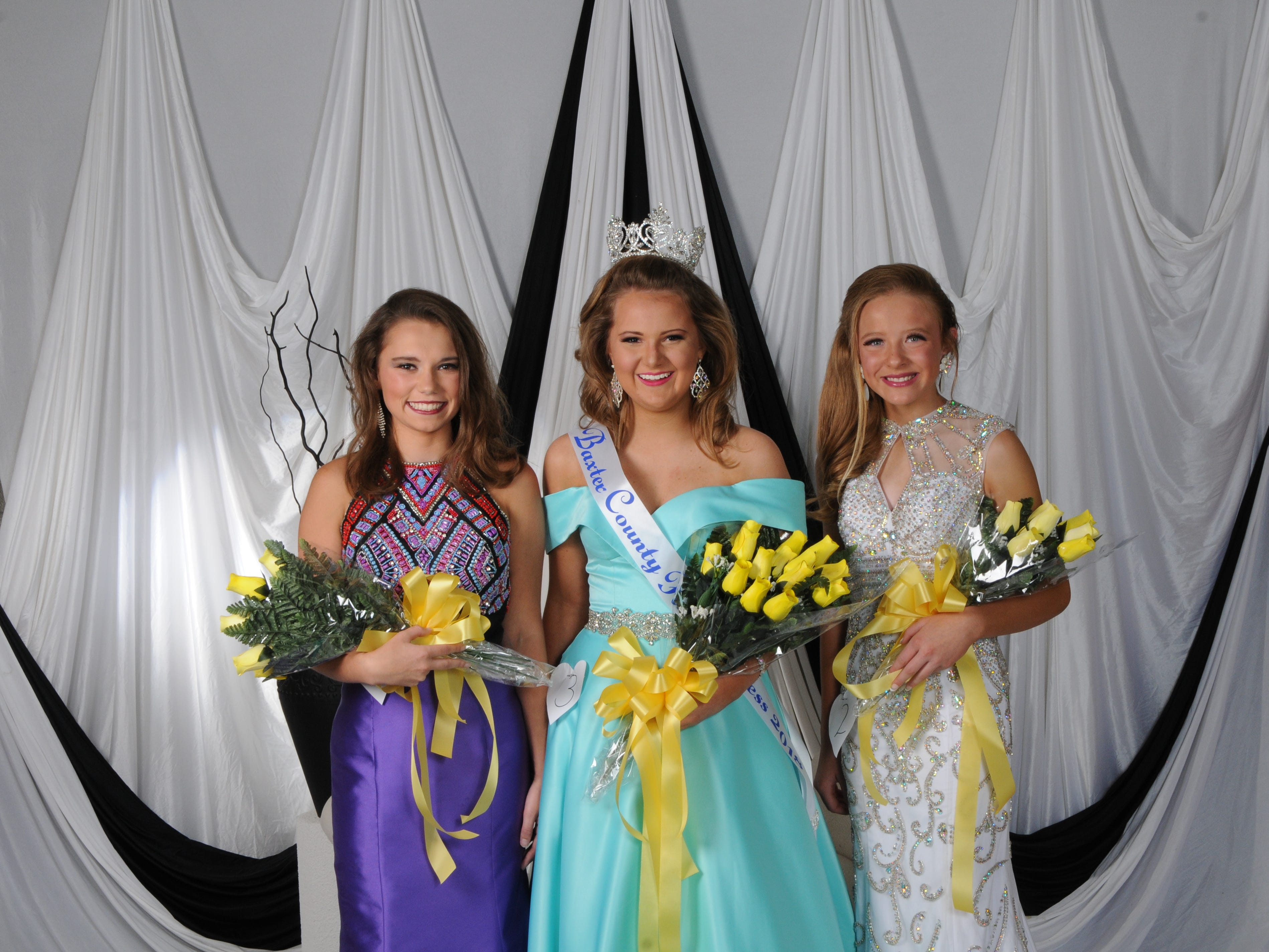 McKenzie Paden (center), daughter of Matt and Michelle Paden of Mountain Home, was named Baxter County Fair at the annual Baxter County Fair Pageant on Saturday at Dunbar Auditorium. McKenzie Tolbert (right), daughter of Donny and Melissa Tolbert of Jordan, was named first alternate; and Brionna Wescoat (left), daughter of Jay and Jill Wescoat of Mountain Home, was named second alternate.