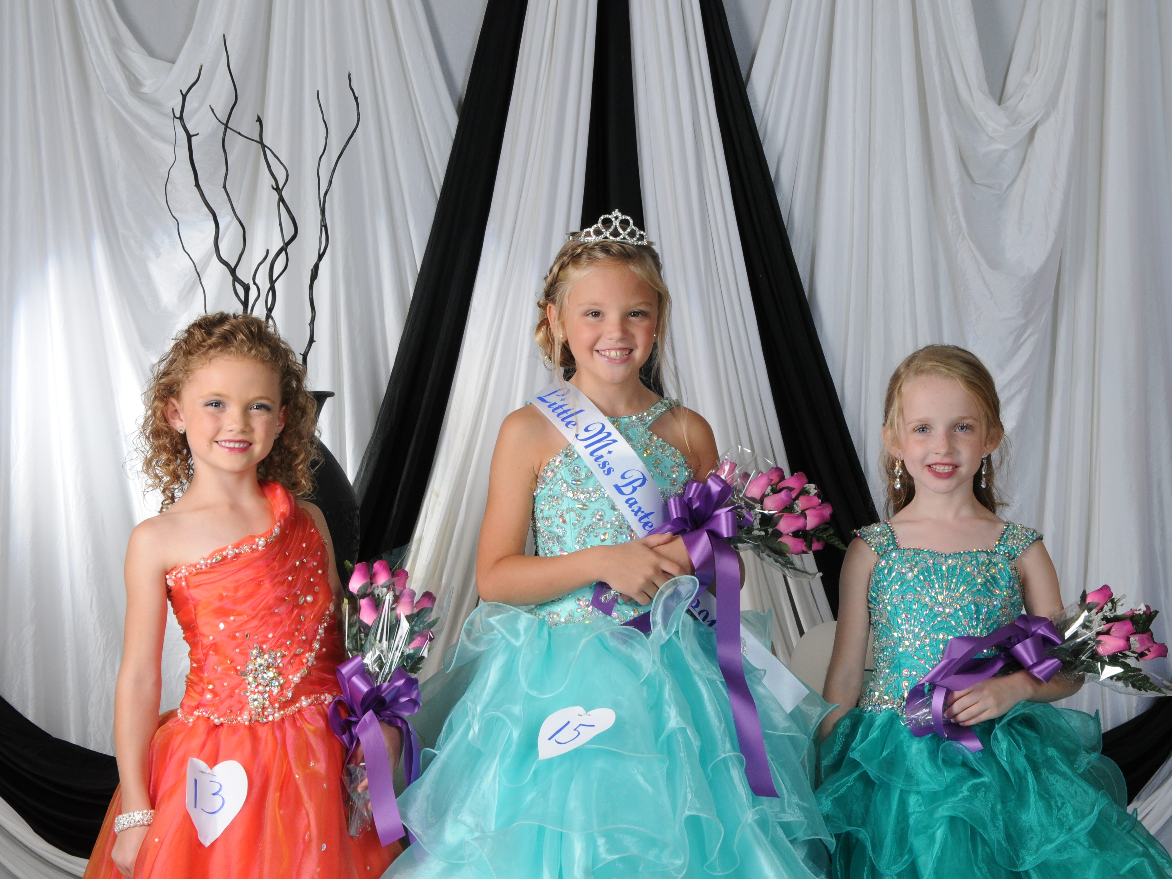 Ally Wheeler (center), daughter of Dusty and Monica Wheeler of Mountain Home, was named Little Miss Baxter County at the annual Baxter County Fair Pageant on Saturday at Dunbar Auditorium. Marlee Dewey (right), daughter of Jeremy and Sarah Dewey of Mountain Home, was named first alternate; Chloe Wilson (left), daughter of Jarret and Jill Wilson of Mountain Home, was named second alternate; and Lindy Lueck (not pictured), daughter of Nathan and Monica Lueck of Mountain Home, was the People's Choice winner.