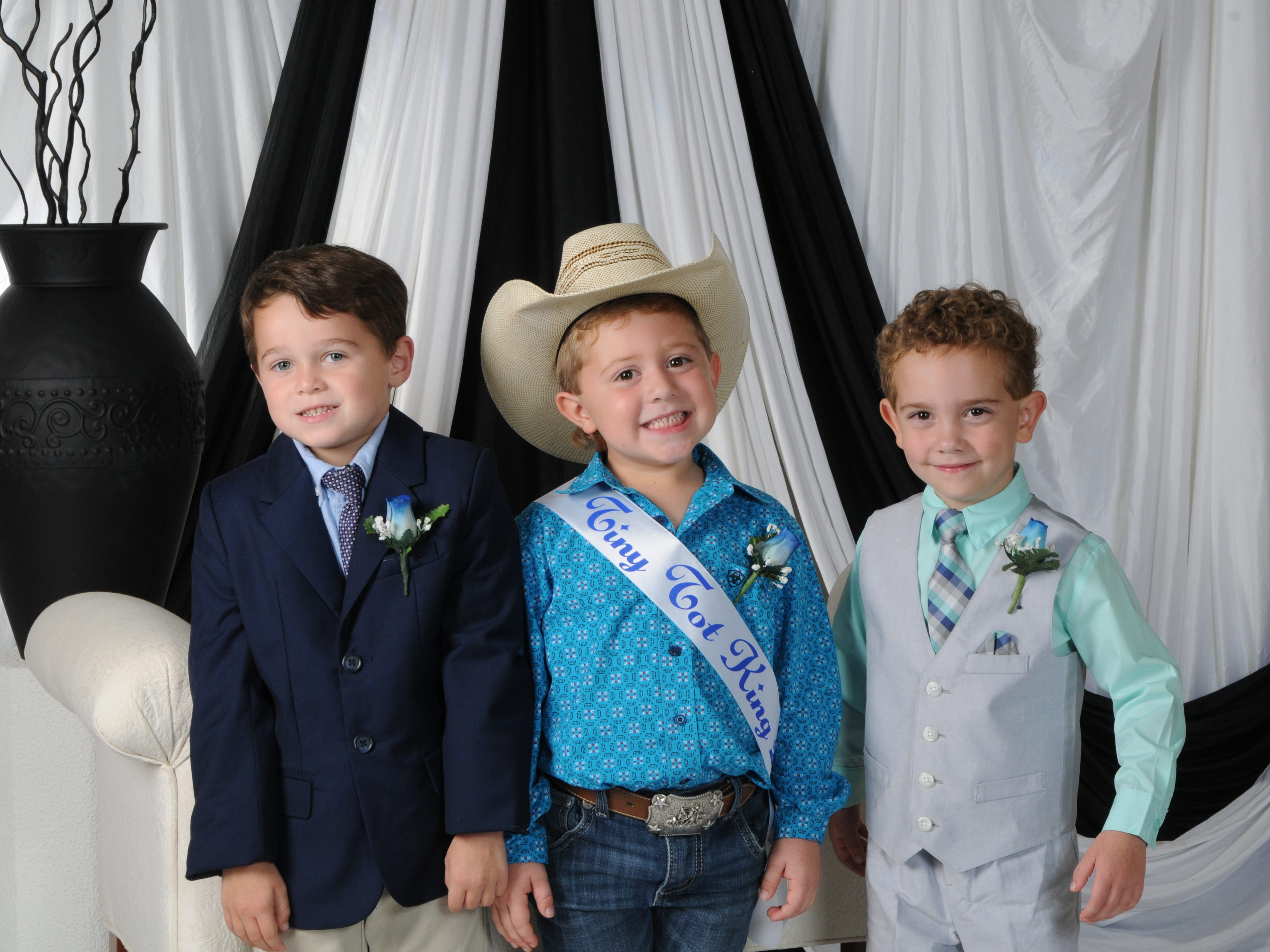 Kash Burleson (center, son of Brandon and Karissa Burleson of Mountain Home, was named Tiny Tot King at the annual Baxter County Fair Pageant on Saturday at Dunbar Auditorium. River Johnson (right), son of Bryan and Jessica Johnson of Mountain Home, was named first alternate; Henry Wunderlin (left), son of Timothy and Megan Wunderlin of Mountain Home, was named second alternate.