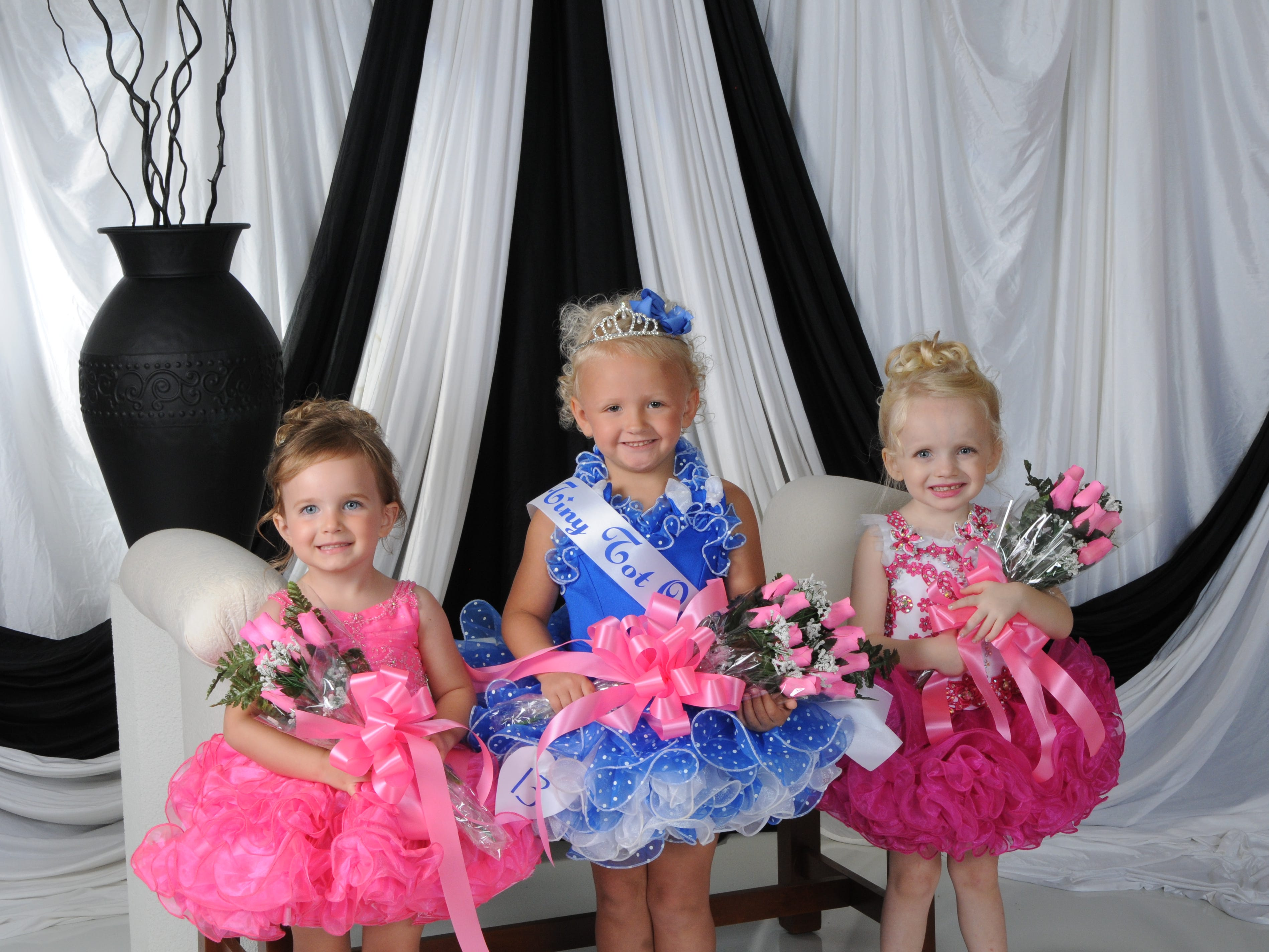 Myla Wheeler (center), daughter of Dusty and Monica Wheeler of Mountain Home, was named Tiny Tot Queen at the annual Baxter County Fair Pageant on Saturday at Dunbar Auditorium. Parker Dewey (right), daughter of Jeremy and Sarah Dewey of Mountain Home, was named first alternate; Abigail Burkhart (left), daughter of Johnnie and Jenny Burkhart of Mountain Home, was named second alternate; and Emerie Rogers (not pictured), daughter of Matt and Ashley Rogers of Mountain Home, was the People's Choice winner.