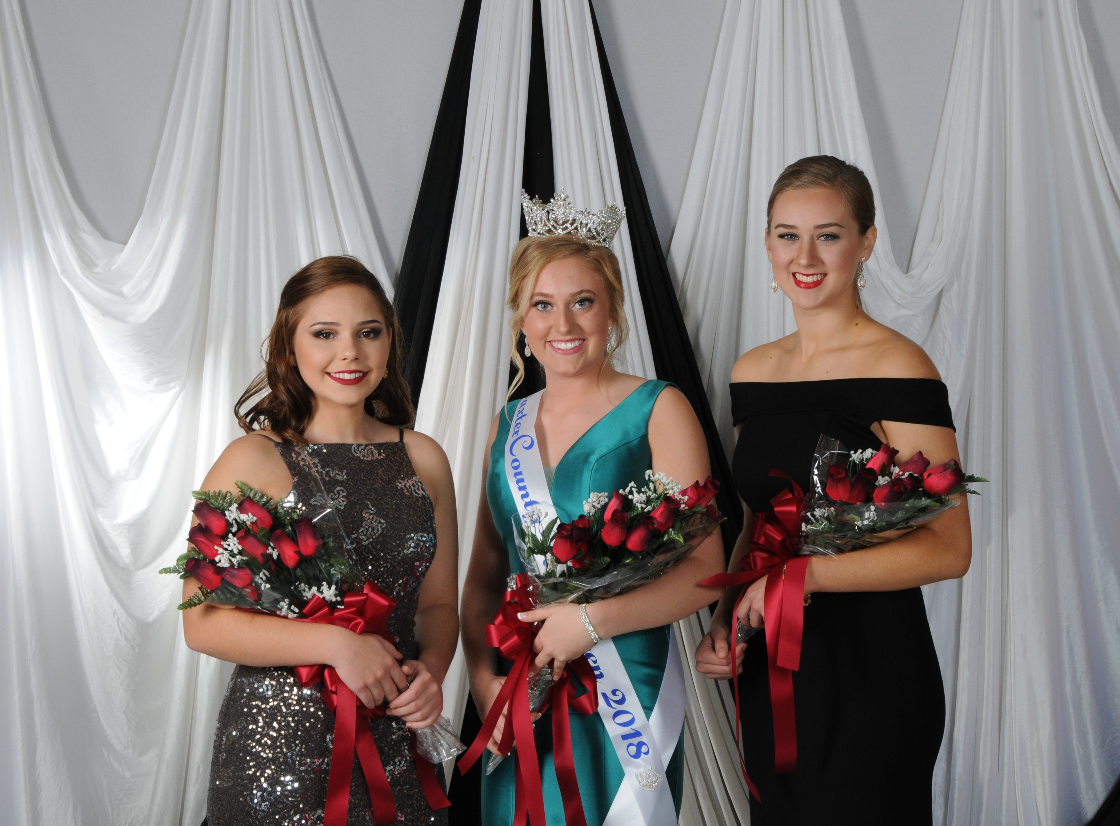 Logann Merriman (center), daughter of Chad and Julie Merriman of Mountain Home, was named Baxter County Fair Queen at the annual Baxter County Fair Pageant on Saturday at Dunbar Auditorium. Mackenize Drewry (right), daughter of David and Jennifer Drewry of Mountain Home, was named first alternate; Sydney Lawhorn (left), daughter of Tommy and Leslie Lawhorn of Mountain Home, was named second alternate; and Kasady Sutterfield (not pictured), daughter of Clayton and Andria Moore of Mountain Home, was named the People's Choice winner.