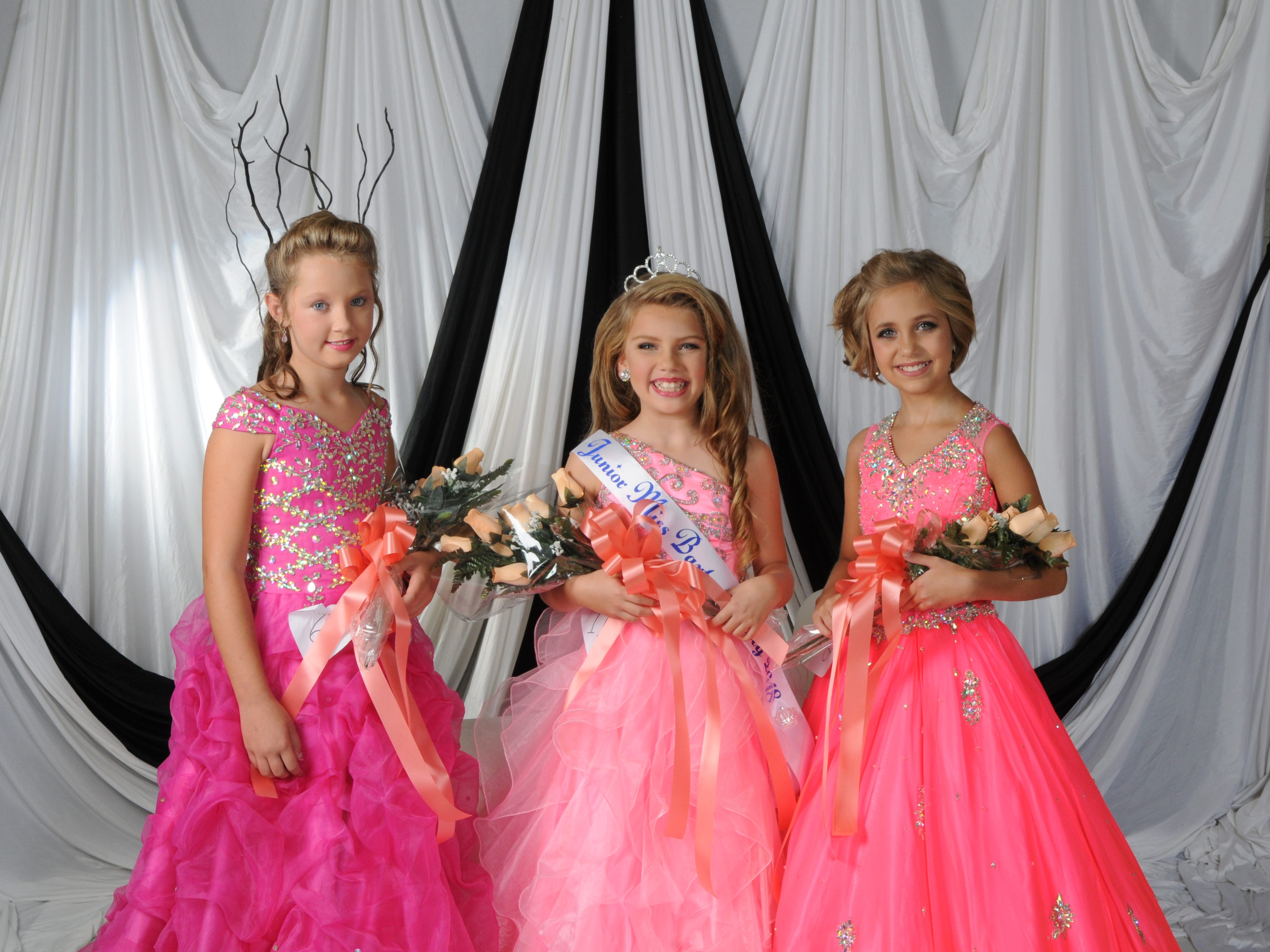 Isabella Sanders (center), the daughter of Steven and Danielle Sanders of Mountain Home, was named Junior Miss Baxter County at the annual Baxter County Fair Pageant on Saturday at Dunbar Auditorium. Piper Edington (right), daughter of Jeff and Carla Edington of Mountain Home, was first alternate; Jaycie Burroughs (left), daughter of Jason and Candace McCoy of Gassville, was second alternate; and Morgan Price (not pictured), daughter of Kyle and Angela Price of Mountain Home, was the People's Choice winner.