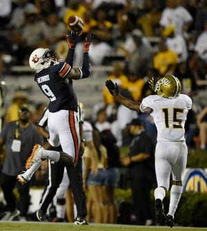 Auburn safety Jamien Sherwood gets an interception in the second half of a win over Alabama State on Saturday, Sept. 8, 2018 in Auburn, Ala.