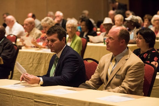 Walt Maddox, Democratic nominee for Governor, left, and Will Ainsworth, Republican nominee for Lt. Governor wait to speak during the Public Retiree Convention at Renaissance Hotel in Montgomery, Ala., on Tuesday, Sept. 11, 2018.