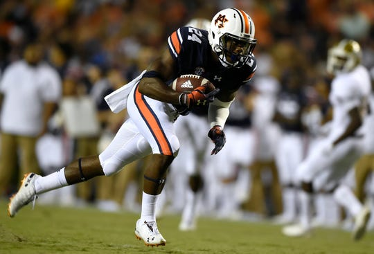 Auburn safety Daniel Thomas returns an interception for a touchdown against Alabama State on Saturday, Sept. 8, 2018 in Auburn, Ala.