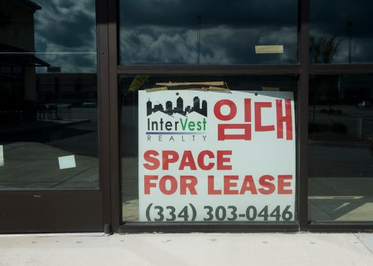 A for lease sign with English and Korean wording at a strip mall of Eastern Blvd. in Montgomery, Ala., on Tuesday, Sept. 11, 2018.