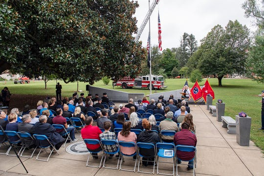 With MTSU and Murfreesboro Fire Department flags at half-mast, Jan Edens of Lebanon, Tenn., tells an attentive audience how she became a Gold Star Mom, losing stepson Jason Edens as casualty of war in April 2012. The MTSU 9/11 Remembrance ceremony at the Veterans Memorial was held Sept. 11.