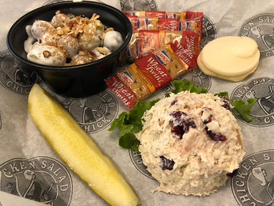 The Chick, which is Chicken Salad Chick's combo, comes with a scoop of chicken salad (this is the Cranberry Kelli) with a side (grape salad), a pickle spear, crackers and a cookie.