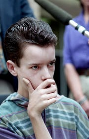 John Trotwood Moore Middle School student Charlie Herbst looks on as his attorney, Robert Turner, talks with the media as they were leaving the Metro police station on April 22, 1994. Herbst brought his mother's .25-caliber semiautomatic pistol to school the day before, where another student accidentally killed Terrance Murray with it.