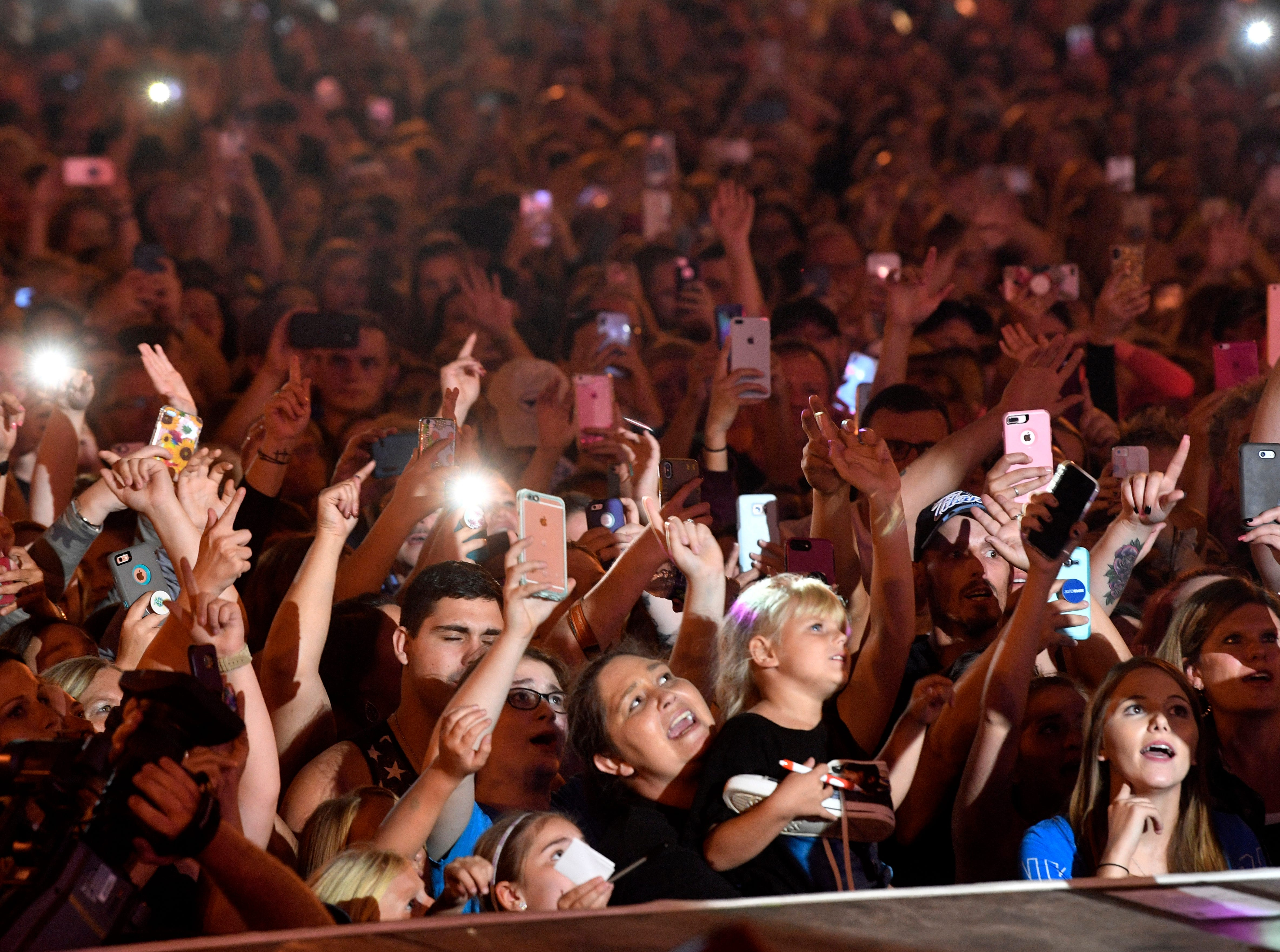 Fans get excited as Luke Bryan performs a concert for fans in front of his new bar Luke's 32 Bridge at 3rd and Broadway Monday Sept. 10, 2018, in Nashville, Tenn.