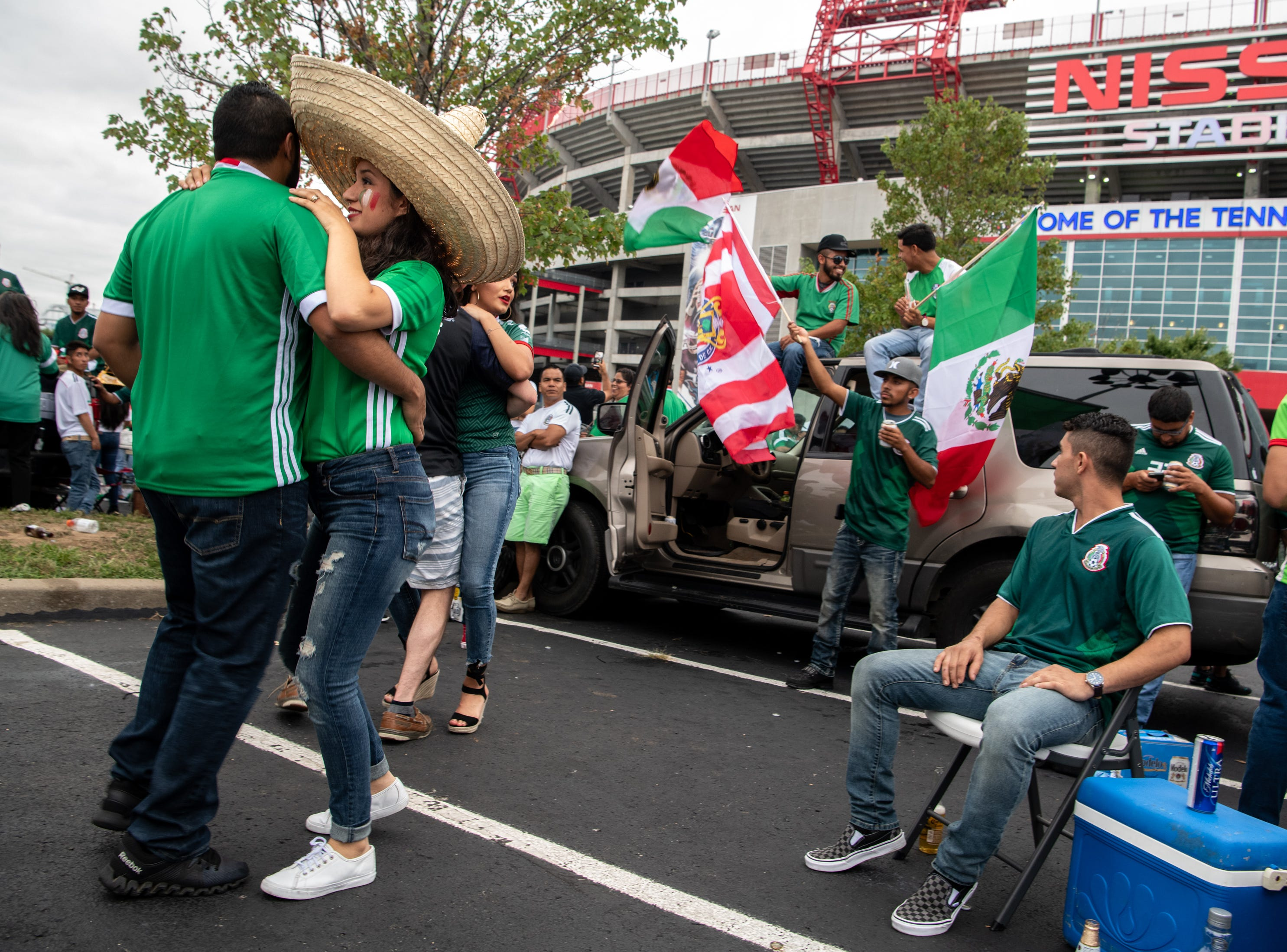 Fans tailgate outside of the stadium before the game between USA and Mexico at Nissan Stadium in Nashville, Tenn., Tuesday, Sept. 11, 2018.