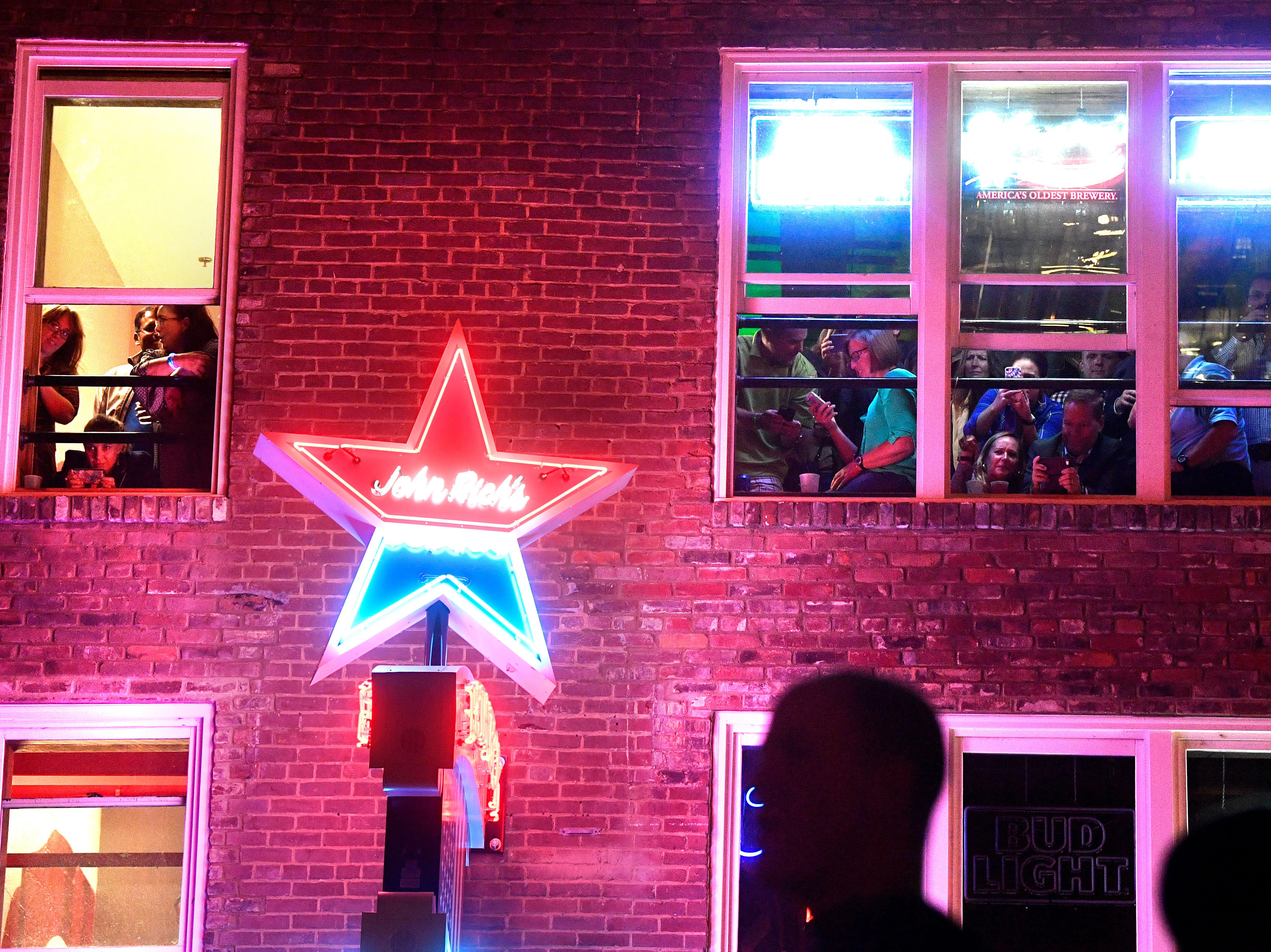 Fans crowd surrounding buildings for a good view as Luke Bryan performs a concert for fans in front of his new bar Luke's 32 Bridge at 3rd and Broadway Monday Sept. 10, 2018, in Nashville, Tenn.