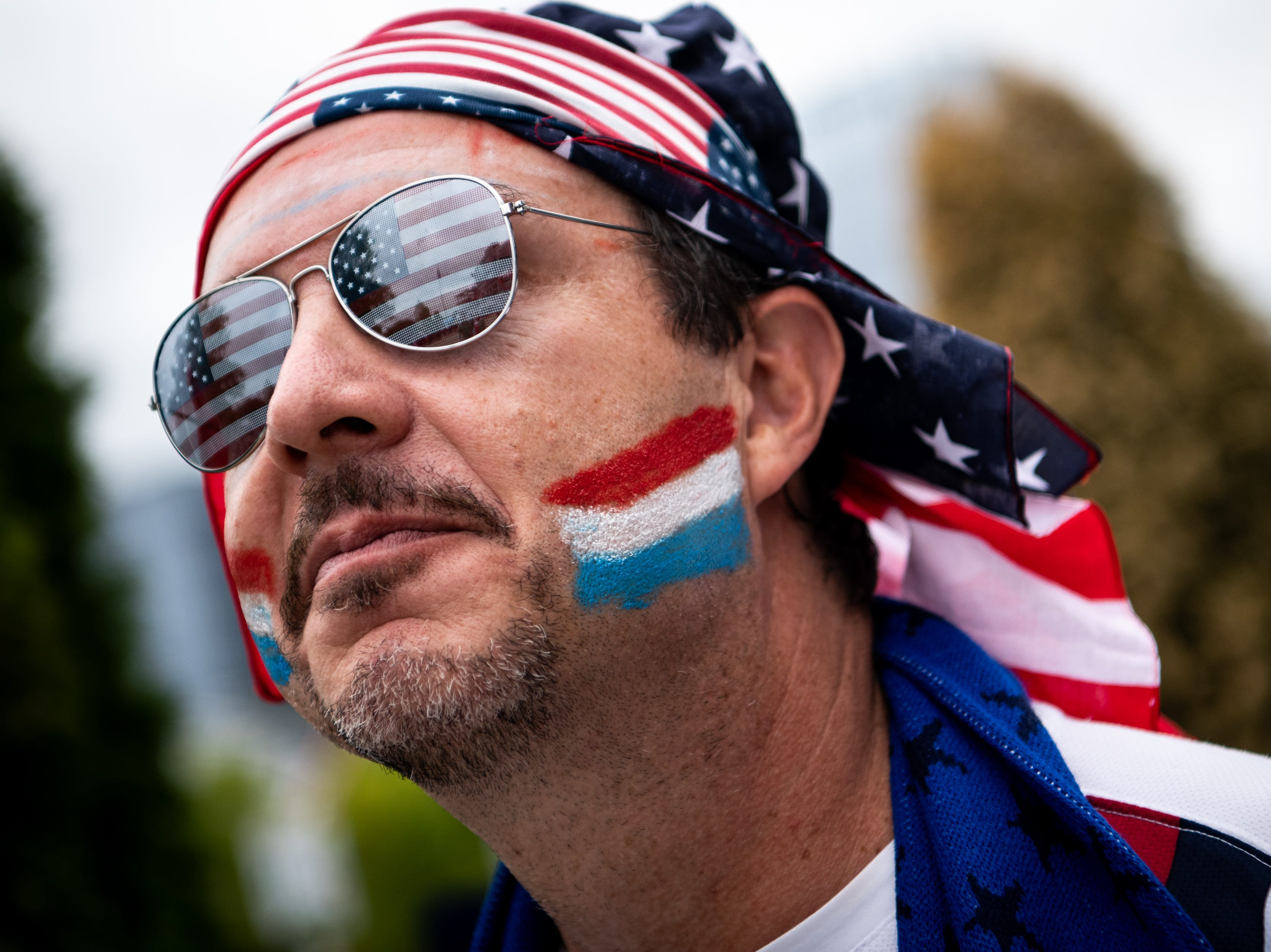 Cisco Hodges, of Asheboro, N.C., waits outside of the stadium before the game between USA and Mexico at Nissan Stadium in Nashville, Tenn., Tuesday, Sept. 11, 2018.