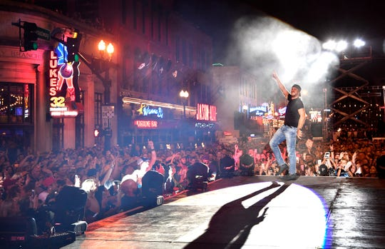 Luke Bryan performs a concert for fans in front of his new bar Luke's 32 Bridge at 3rd and Broadway