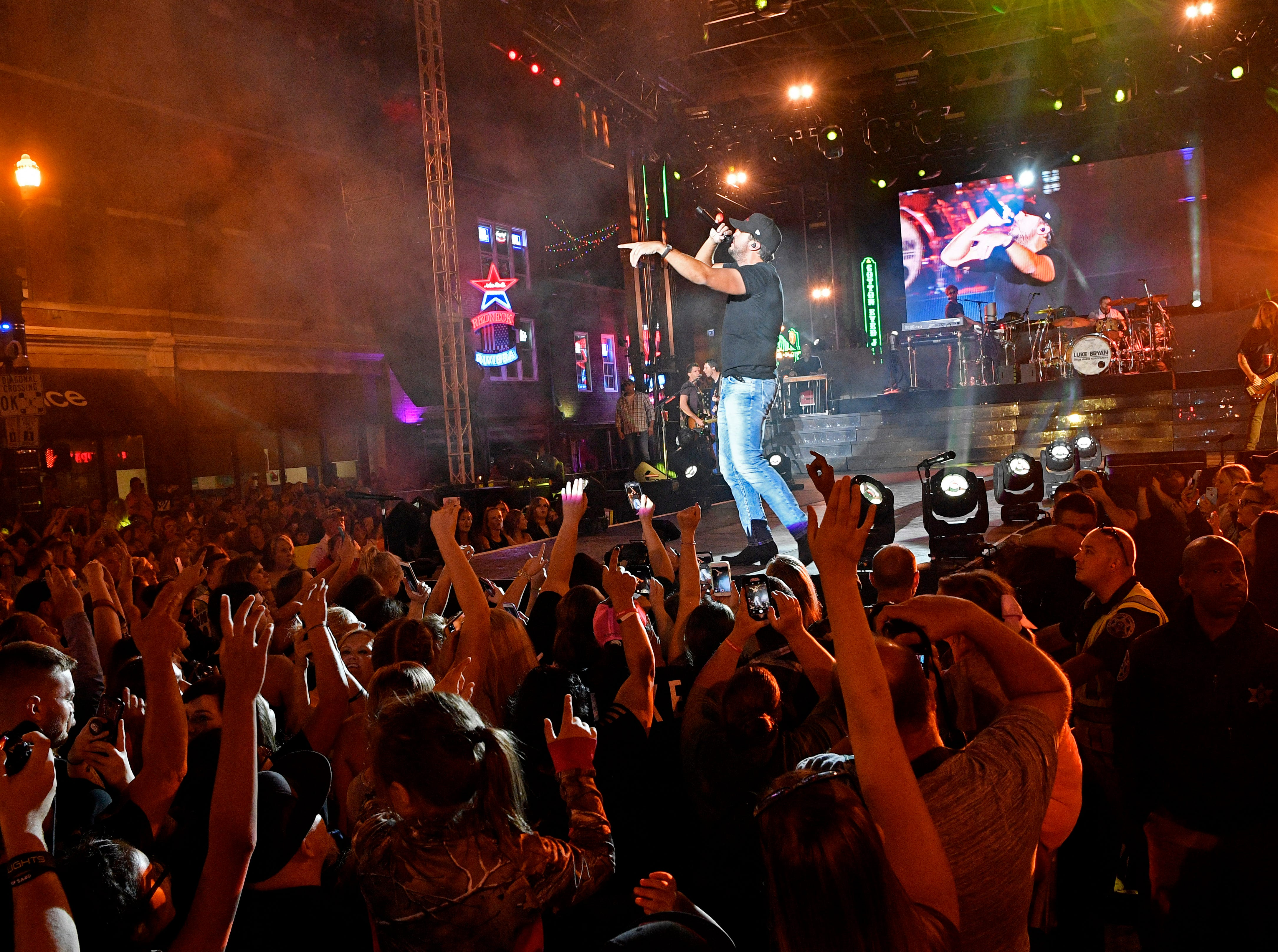Luke Bryan performs a concert for fans in front of his new bar Luke's 32 Bridge at 3rd and Broadway Monday Sept. 10, 2018, in Nashville, Tenn.